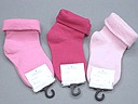Plain pink baby socks with turnover top