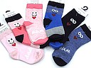 Baby socks with a face and mum or dad text